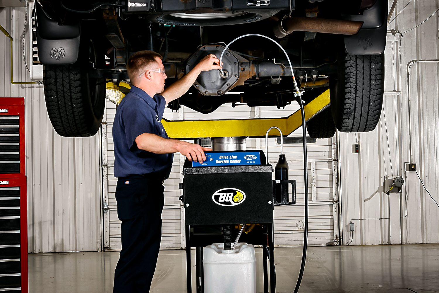 bg product differential fluid maintenance service being performed